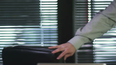 A businessman sits down and video chats on his computer. - stock footage