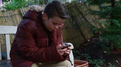 Boy texting friend Stock Footage