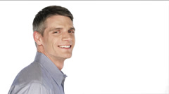 Man smiles into the camera then turns his head on a white background Stock Footage