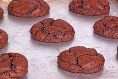 Freshly baked, home-made chocolate cookies still on the pan Stock Photos