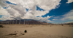 4K time lapse of clouds passing over wind turbines in Palm Springs, California Stock Footage
