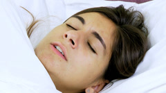 Woman with strong flu feeling sick in bed closeup Stock Footage