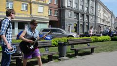 Charismatic guitarist play guitar in street music event Stock Footage