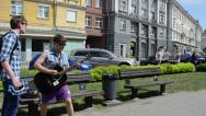 Stock Video Footage of charismatic guitarist play guitar in street music event