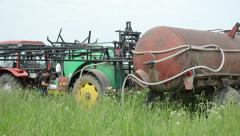 Tractors and tank filling with pesticides farmer Stock Footage