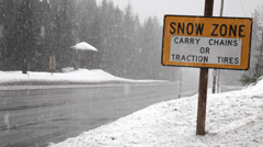 Sign of the carry chains or traction tires on a highway snowing. Stock Footage