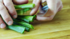 CU Hands cutting chive - stock footage