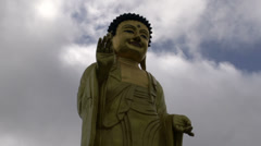 Time lapse from clouds moving by for the Golden Buddha Stock Footage