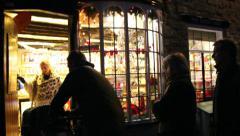 Christmas lights enter shop Stock Footage