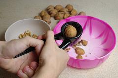 Wallnut shelling Stock Photos