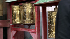 Girl hand touching the prayer wheels near the Gandan Monastery Stock Footage