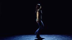 WS Studio shot of young woman dancing - stock footage