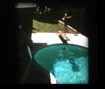 Little blonde girl stops short of diving into pool Stock Footage