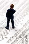 share prices in a newspaper - stock photo
