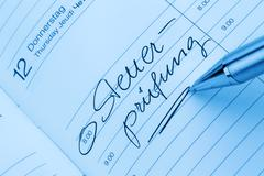 entry to the calendar: tax audit - stock photo