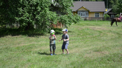 Kids children boys play with bubble blow gun in outdoor festival Stock Footage
