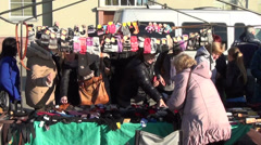 People vendor woman tent sell various gloves for winter time Stock Footage