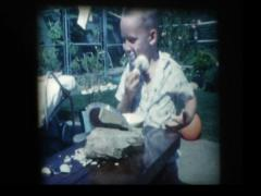 Young boy applies shaving cream with brush Stock Footage
