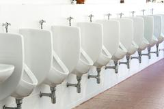 mens public toilet - stock photo