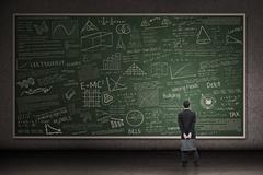 Businessman looking at hand drawn chalkboard Stock Illustration