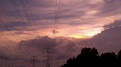 Time-lapse of high voltage line in sunset. Stock Footage