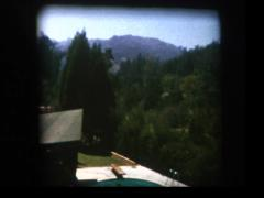 Southern California suburban pool and hillsides 1961 Stock Footage
