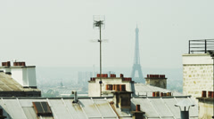 WS HA LS Eiffel Tower over rooftops / Montmartre, Paris, France Stock Footage