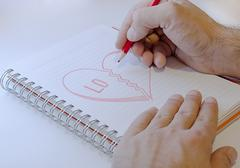 Draw hart with red crayons Stock Photos