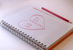 draw hart with red crayons - stock photo
