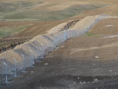 Aita ja piikkilanka-suojelun alueella Irakissa Kuvituskuvat