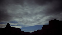 T/L WS Clouds moving over rocks / Green River, Utah, USA Stock Footage