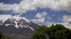 T/L WS PAN Clouds moving over snowcapped peak / Orem, Utah, USA Stock Footage