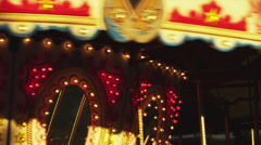 CU Illuminated carousel spinning at night / American Fork City, Utah, USA Stock Footage