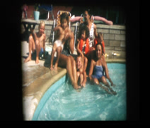 Family poses for picture in swimming pool Stock Footage