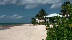 Cayman Islands, a part of seven mile beach, residential villa and exotic plants Stock Footage