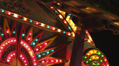 CU LA People on illuminated amusement park ride at night / American Fork, Utah, Stock Footage