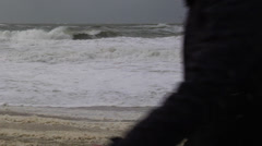 Kid watching Storm on the Beach Stock Footage