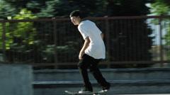 WS T/S Skateboarder sliding rail / Orem, Utah, USA Stock Footage