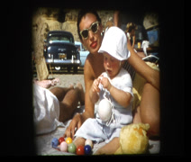 50s glam mom and baby on beach - stock footage