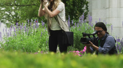 MS TU Man with movie camera and woman photographing in garden / Salt Lake City, Stock Footage