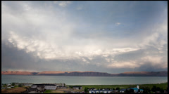 T/L WS Dramatic sky over Bear Lake, day to night, Utah, USA Stock Footage
