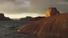 WS Lake Powell waves splashing against rocky coast at sunset / Utah, USA Stock Footage