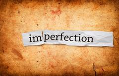 Imperfection title on old paper Stock Photos