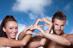 Young couple has joined hands in a heart shape Stock Photos