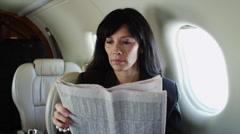MS Businesswoman reading newspaper in airplane / Spanish Fork, Utah, USA Stock Footage