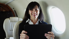 MS Businesswoman watching movie on digital tablet in airplane / Spanish Fork, - stock footage