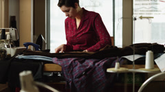 MS TU Young female fashion designer at work, / Provo, Utah, USA Stock Footage