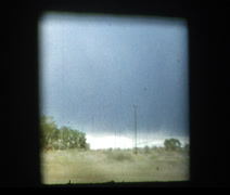 1955 driving in stormy skies Stock Footage