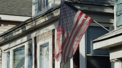 MS American flag in front of house / Queens, New York City, New York, USA Stock Footage