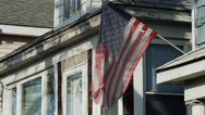 Stock Video Footage of MS American flag in front of house / Queens, New York City, New York, USA
